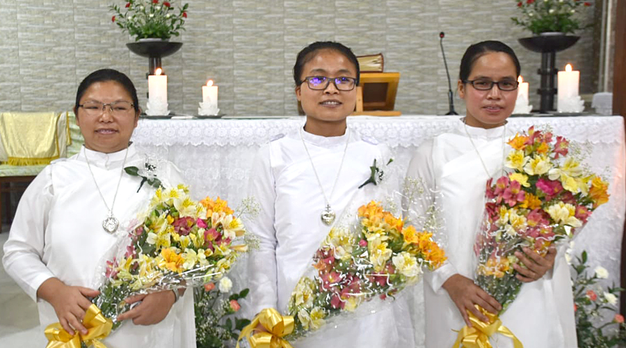From left, Holy Cross Sisters Nobina Rangsa Marak, Shadkmenlang Kharsahnoh and Isidora Dkhar professed their perpetual vows on April 17, 2021, at the Grotto Chapel of the Cathedral of Mary Help of Christians, Shillong, Meghalaya, India.