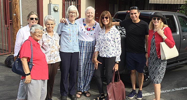 Six alumnae of Saint Mary's College, Notre Dame, Indiana, attended the farewell Mass for the sisters; three are pictured here (in sunglasses). From left, friend Judi Woodley (in front), Maureen Cassidy, Sisters Mary Alice Bowler, Patricia Anne Clossey and Maryanne O'Neill, Lucy DaGiau, Father Luis Espinoza of St. Agnes Catholic Church, and Amy Sinclair.