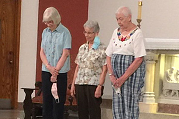 Sisters Patricia Anne Clossey, Mary Alice Bowler and Maryanne O'Neill were honored at a Mass for their service to the Brother André Outreach Center.