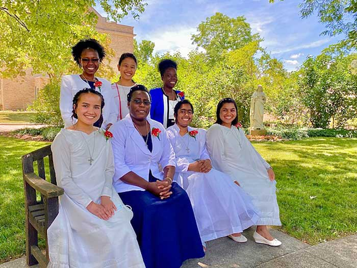 The seven sisters who made their initial professions on June 19 are: from left, standing, Sisters Dorothy Achieng, Lupa Hajong and Lydia Issah; rom left, seated, Sister, Risha Mery Nonglang, Margret Kabasiza, Dalia D'Costa and Betbhalin Langrin.