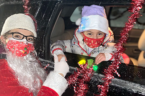 A young PAT participant greets Santa.