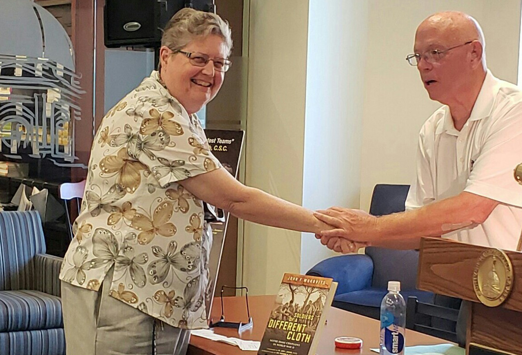 Sister Catherine Osimo, CSC, greets John F. Wukovits, author of Soldiers of a Different Cloth: Notre Dame Chaplains in World War II, at a book signing event on August 30 at the University of Notre Dame.