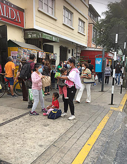 Sister delivers brown bag breakfasts to family in Lima, Peru.