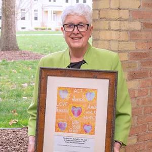 Sister Judith Anne Beattie, CSC presents her award from University of Notre Dame's Center for Social Concerns.