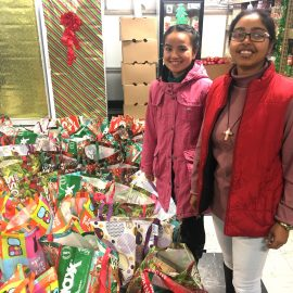 Novices Sister Risha Mery Nonglang, left, and Sister Magdelana Boiragi assisted with Broadway Christian Parish United Methodist Church's Christmas Jubilee in December. A donation from the Simple Meal Day Fund provided food and toys for the event.