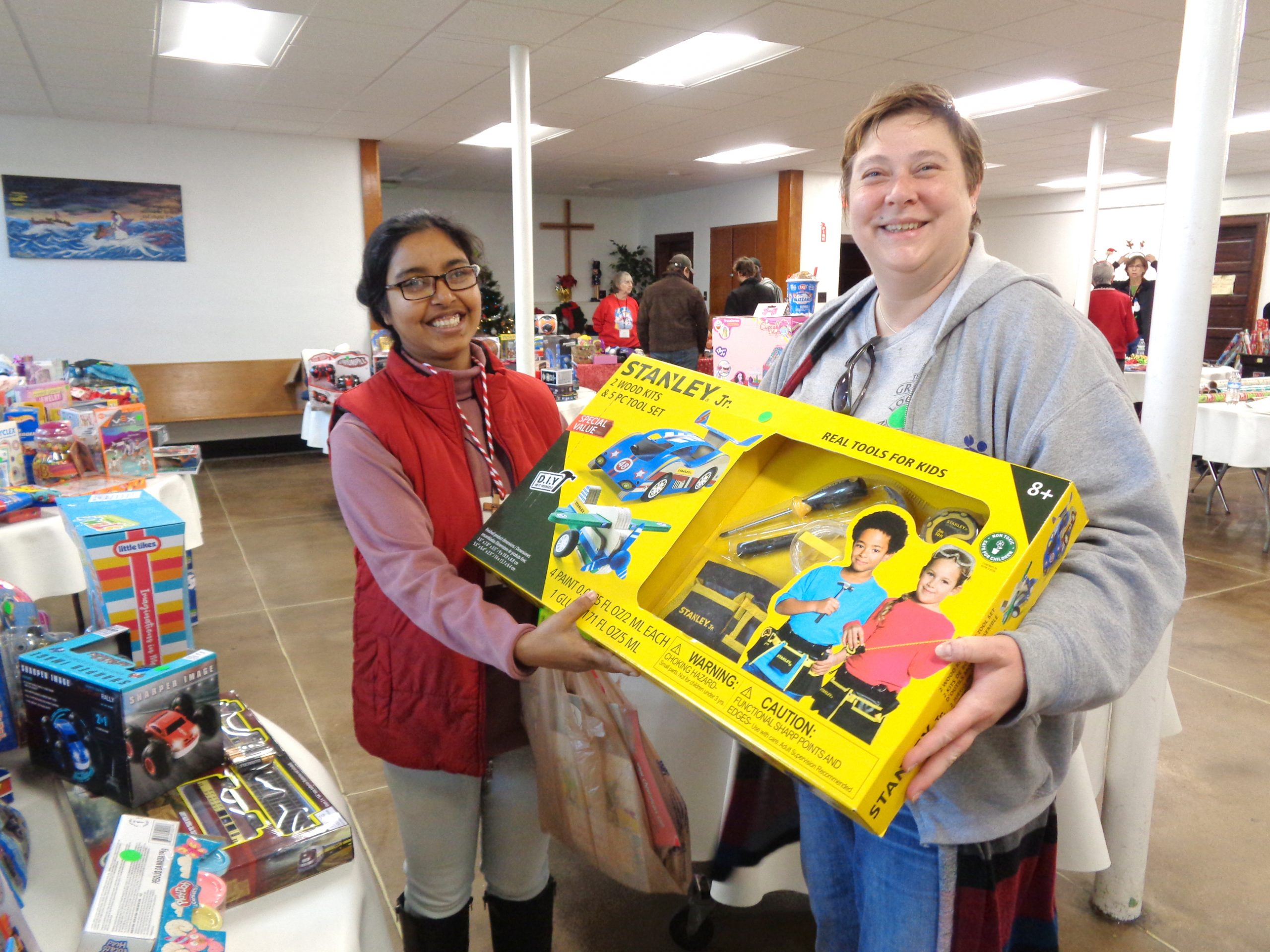 Sister Magdelana helps a mom sort through toys, games and books for a gift for her son.