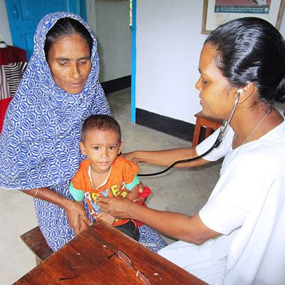 Sister Renu Teresa Rozario, CSC, attends to patients at the Holy Cross Health Education Center in Kulaura, Bangladesh. The center serves 6,500 people annually.