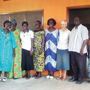 Holy Cross Sisters are welcomed by the mothers and aunties of St. Jude Children's Home, Gulu, Uganda, and by Father Michael Lawrence Komakec, vicar general of the Gulu Archdiocese. Pictured are Sisters Lilian Briege Awino, CSC, second from left; Grace Kitinisa, CSC, fifth from left; and Mary Louise Wahler, CSC, second from right.