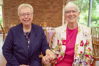 Holy Cross Sisters Florence Mary (May), left, and Karen Anne Jackson, both 60-year jubilarians, share a moment during the jubilee festivities at Saint Mary's.