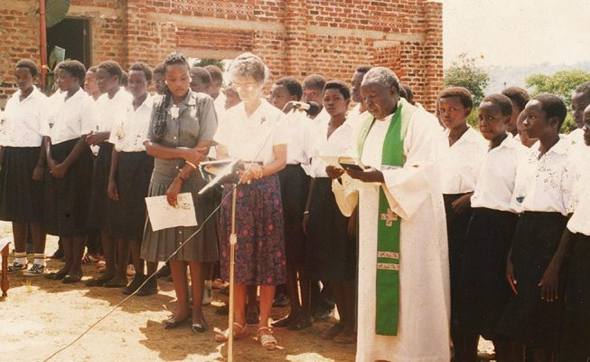 Sister Mary Louise, Father Andrew Isabirye and students participate in blessing the school in 1993.