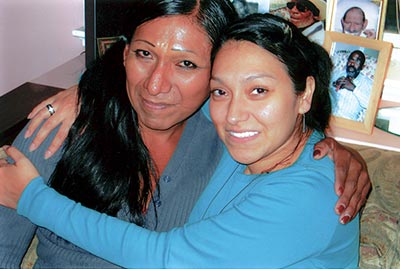 Sister Miriam Nohemí Arizpe Paredes right, hugs a woman in recovery.