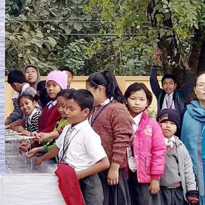 Headmistress Sister Khochem Mossang, CSC, (right) supervises while the school children examine the new water filtration tank at Our Lady of Holy Cross School in Barakathal, India.