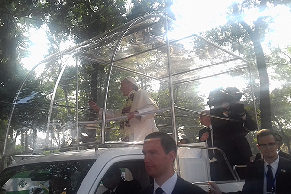 Pope Francis waves to the crowd while visiting Bangladesh.