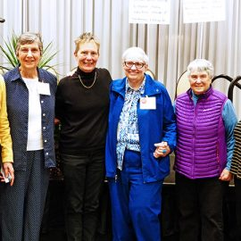 """The documentary """"Quiet Heroes"""" chronicles the work of Dr. Kristen Ries and physician assistant Maggie Snyder— the only health professionals to care for individuals with HIV or AIDS in Utah during the 1980s —and the Sisters of the Holy Cross who ministered with them. Dr. Ries and Ms. Snyder joined some of the Holy Cross Sisters who partnered with them at a gathering at Saint Mary's, Notre Dame, Indiana. Left to right: Sisters Suzanne Brennan and Joan Marie Steadman, Ms. Snyder, Sister Linda Bellemore, Dr. Ries and Sister Bernadette Mulick."""