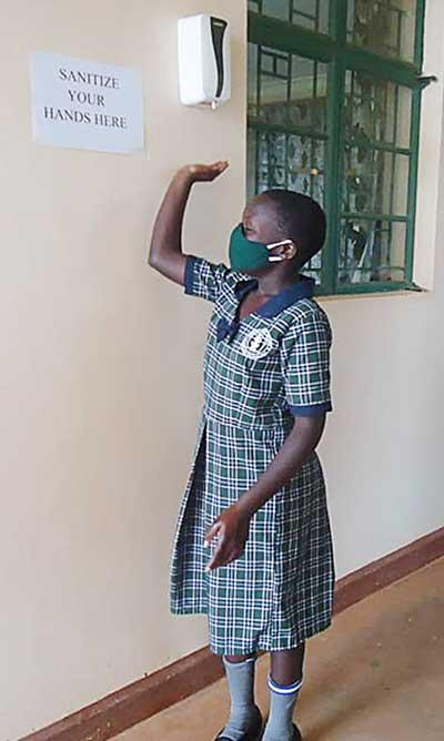 A student at Moreau Nursery and Primary School in  Kirinda, Uganda, returned in October, adhering to pandemic protocols.
