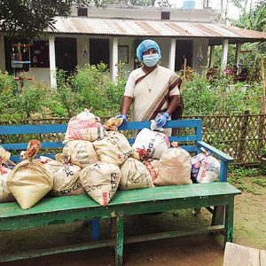 Sister Cecilia Karuna Corraya, CSC, prepares to distribute food to people in Pirgacha, Tangail, Bangladesh. Funds from a grant have enabled the sisters to provide food and continue their outreach ministry.