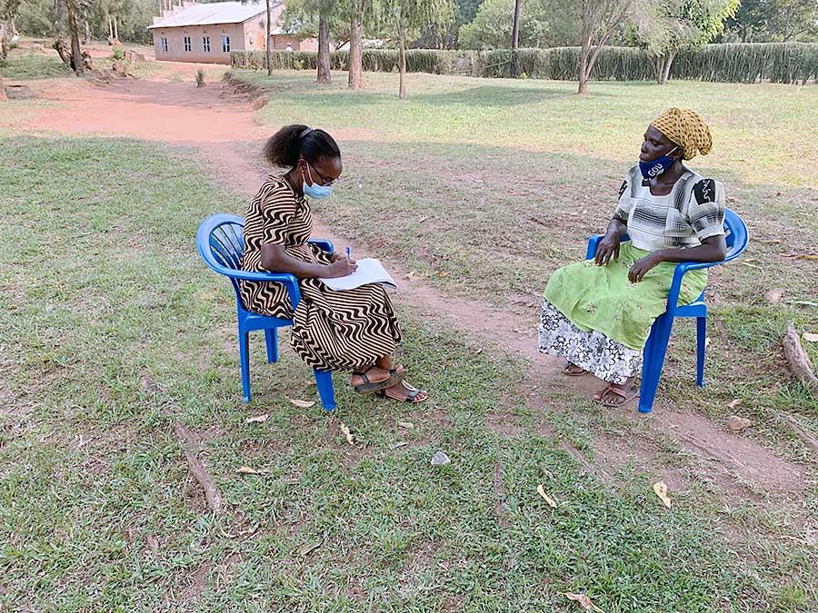Sister Daisy Kabuleeta, CSC, (left) interviews Alice Bonabana, one of the founding members of Kyamugenyi Kweterana.