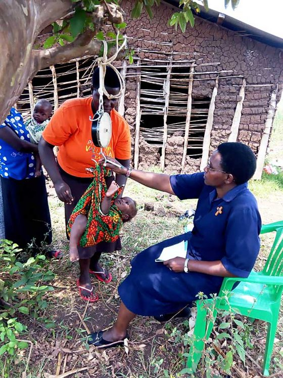 Sister Jacinta works with children getting them critical immunizations that protect against deadly diseases.