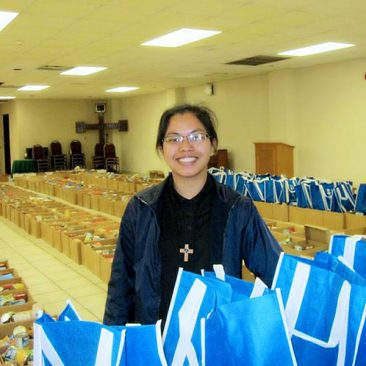 Sister Lina poses with all of the donations of food