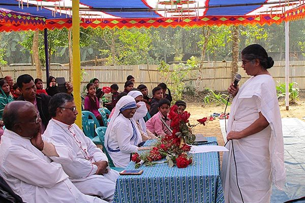 Sister Pushpa Teresa Gomes, CSC, Area of Asia coordinator, left, speaks with the audience during the opening ceremony.