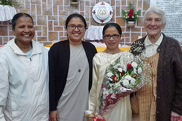 Holy Cross Sister Ridahun Basaiawmoit, pictured with the bouquet of flowers, celebrated her perpetual profession of vows on May 6 in Shillong, India. Family, friends, and members of the Family of Holy Cross, including, from left, Holy Cross Sisters Parboti (Gomes), Rose Mary Marngar and M. Bruno (Beiro), rejoiced with her on the momentous day.