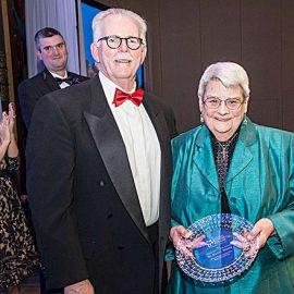 Peter Hodgson, president of Catholic Business Network of Montgomery County, Maryland, presented Sister Kathleen Weber, CSC, with the organization's Community Leader of the Year Award for her devoted work to support those who serve as caregivers to loved ones with cognitive and physical diminishment. Photo credit: Freddy Libermann