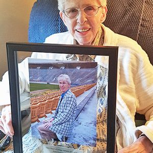 Sister M. Louisita (Welsh) displays a photo plaque commemorating her work as a Saint Mary's College team chaplain and her induction into the college's Athletic Hall Fame. Sister Lou, as she is known, is the first team chaplain to receive the honor.