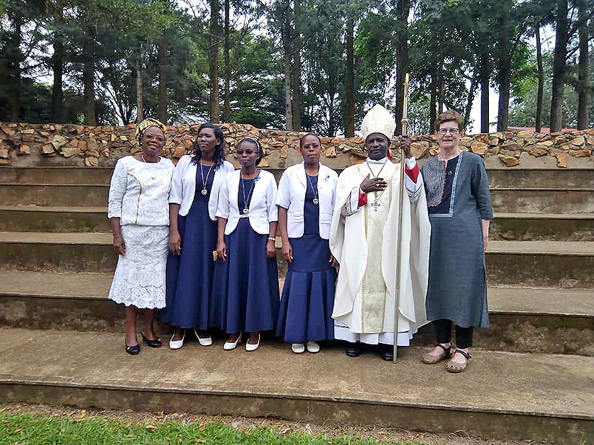 Holy Cross Sisters Grace Kitinisa, Janet Nantumbwe and Jane Aluku Masingir, pictured second from left to right, celebrated their perpetual professions on June 22 in Kyarusozi, Uganda, East Africa.