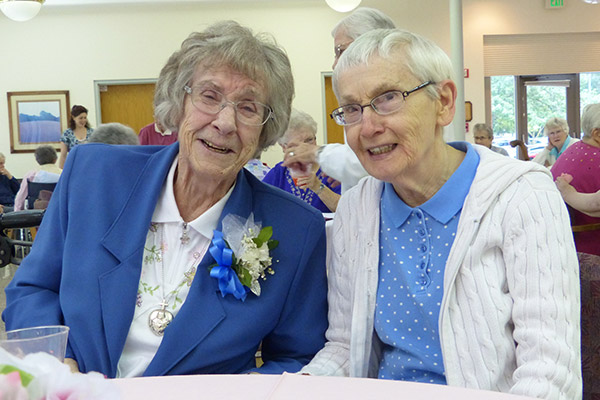 Sister Maureen Cahill and Sister Alice Clare Hosty enjoy each others company during the Jubilee reception
