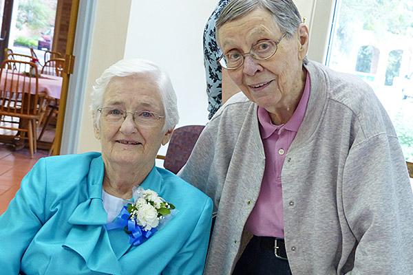 Sister Mary Elizabeth Loughran and Sister Julie McGuire visit during the jubilee celebration