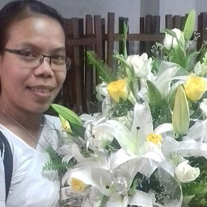 Sister Runu poses with a beautiful bouquet of white lilies and yellow roses she prepared for Pope Francis' visit to Bangladesh.