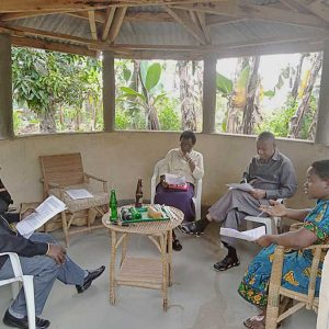 Sister Semerita (far right) meets with her planning group (from left) Joseph Mutabingwa, Sister Angelica Birungi, CSC, and Father Fidelis Safari Mushi.