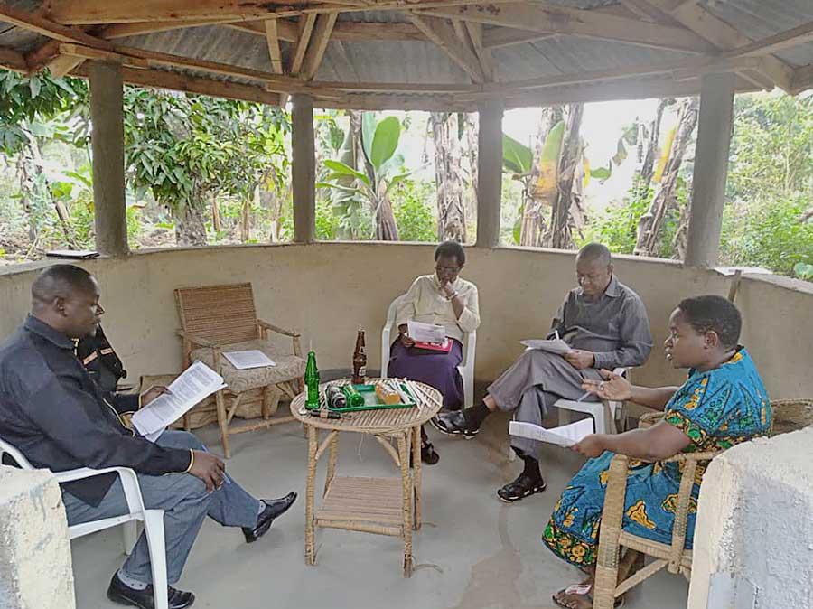 Sister Semerita (far right) meets with her planning group (from left) Joseph Mutabingwa, Sister Angelica Birungi, CSC, and Father Fidelis Safari Mushi.