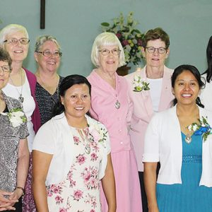 Sisters pose for a celebratory picture following Perpetual Profession in Mexico, 2017