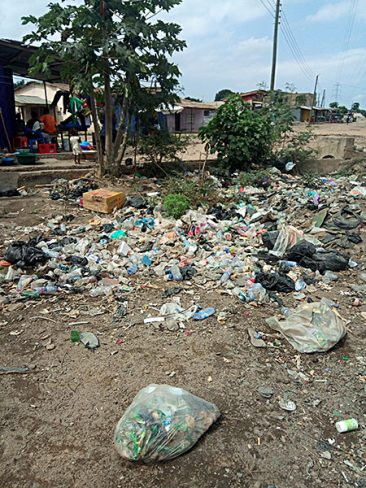 Plastic waste piles up in Kasoa, Ghana, clogging drainage systems.