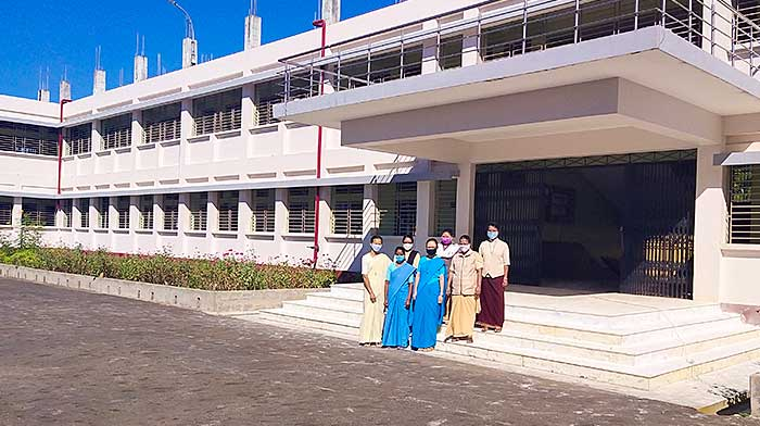 Standing in front of Our Lady of Holy Cross School in Barakathal, India, are (from left) Holy Cross Sisters Mitali Mree, Felicita Corraya, Isidora Dkhar, Khochem Mossang, Nobina Rangsa Marak, Parboti (Gomes) and Molly Jacob
