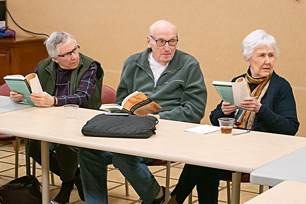 Pictured are participants engaged in a discussion on theology by Sister Frances B. O'Connor, CSC.