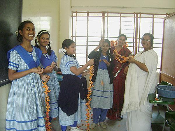 Sister Jamuna preparing garland Moreau Holy Cross School students