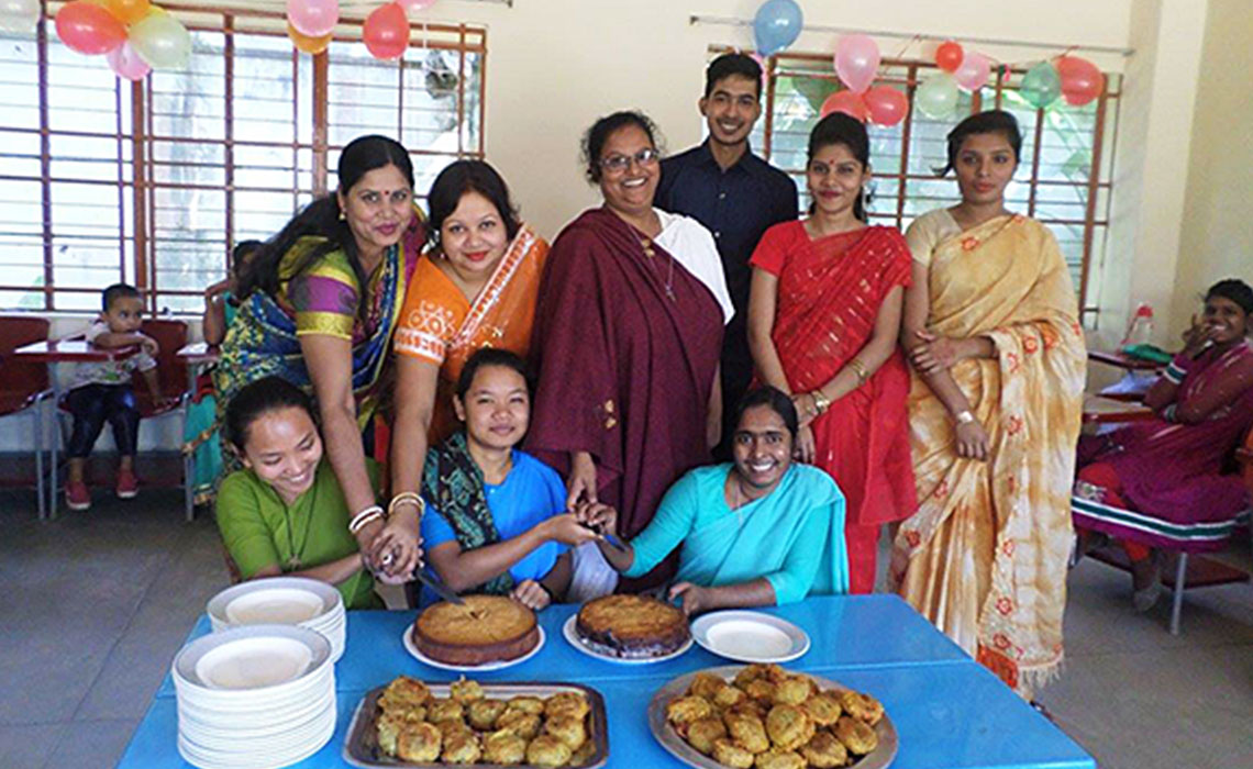 "Sister Jamuna Magdeline Gomes, CSC, headmistress of Moreau Holy Cross School in Bhadun, Bangladesh shares in the ""cutting of the cake"" end-of-year thanksgiving with students and staff."