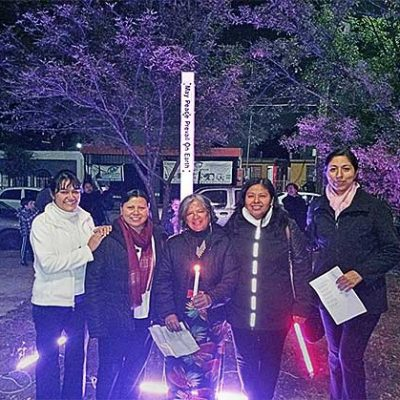 From right are Sisters Nieves Lidia Ortiz Galván and Areli Cruz Hernández, Martha (Associate of the Sisters of Holy Cross), Sisters Esperanza Jacobo Acevedo and Patricia Rodríguez Leal stand together at the peace pole.