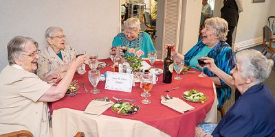 Holy Cross Sisters Eileen Dewsnup, Sister Albertine Kramer, 60-year jubilarian M. Elena (Malits), Shirley Ann Simpson, and Barbara Marie (Kleck), share a toast to the jubilee celebrants.