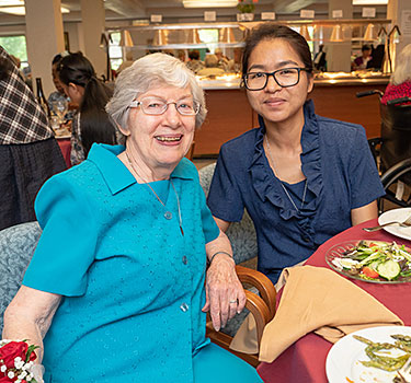 Sister Ellen Mary celebrates with Sister Meri Halam.