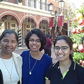 Sister Rita Godhino, CSC, second from left, visits with University of Southern California students after Sunday Mass at Our Savior Parish, Los Angeles.