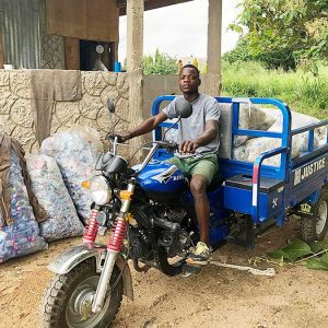 Baaba Suley transports bagged waste for recycling in Kasoa, Ghana, thanks to donor-supported project SOAR, a ministry of the Sisters of the Holy Cross designed to care for creation and reduce poverty.