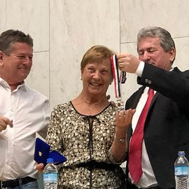 Sister Angela Mary (Carey), CSC, received the Merit of Honor of the São Paulo Legislature. The award was given by representative Enio Tatto, right. At left is city councilman Arlindo Tatto.
