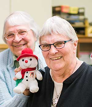 Sister M. Carlita (Hammes), CSC, left, and Sister Carmel Marie (Sallows), CSC, enjoy a light-hearted moment at the motherhouse at Saint Mary's, Notre Dame, Indiana.