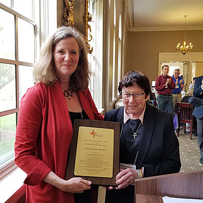 Photo provided by the National Association of Catholic Chaplains. Pictured are Bridget Deegan-Krause, left, and Sister M. Emily (Demuth), CSC, at the 2019 Annual Awards presentation at the National Association of Catholic Chaplains (NACC) Conference. Sister Emily was awarded the 2019 Distinguished Service Award from the NACC. Bridget-Deegan Krause is a NACC member, chaplain and friend of Sister Emily.