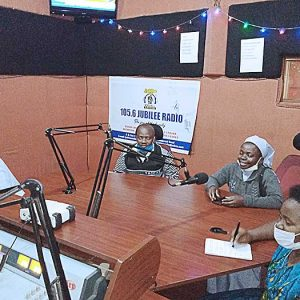 Sister Semerita Mbambu, CSC, right, organized a radio program and announcements to address increased instances of family violence in areas of Uganda during the coronavirus pandemic.