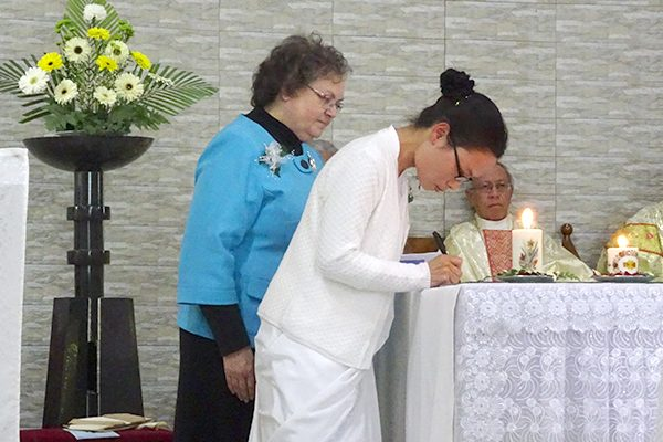 Sister Khochem Mossang signs her vows