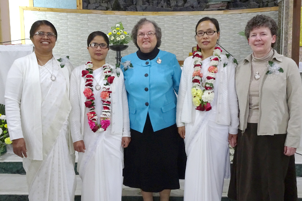 The perpetually professed sisters stand with members of the Congregation General Leadership Team